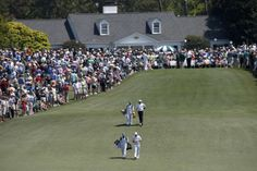 National Golf Club in... Less    U.S. golfers Fred Couples (rear) and Jimmy Walker walk down the first fairway during the third round of the Masters golf tournament at the Augusta National Golf Club in Augusta, Georgia April 12, 2014. REUTERS/Mike Segar