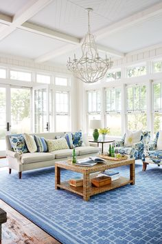 In the living room, unadorned windows transoms maximize natural light. Featuring windows on three sides of the sunny area, it could have been a show-stopping spot for draperies. But with stunning Lake Erie just outside, the views proved too beautiful to compete with.
