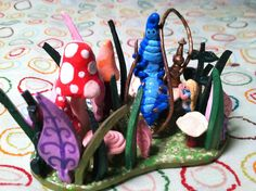 Handmade Alice In Wonderland and Caterpillar Polymer Clay Sculpture. $44.99, via Etsy.