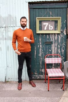 Shop this look for $130:  http://lookastic.com/men/looks/orange-crew-neck-sweater-and-white-dress-shirt-and-black-jeans-and-burgundy-brogues/1094  — Orange Crew-neck Sweater  — White Dress Shirt  — Black Jeans  — Burgundy Leather Brogues