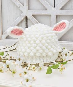 Sweet Lamb Crochet Hat - This little lamb hat is crocheted with bobble stitches for the perfect texture. Pattern is in two sizes to fit baby and toddler cuties. Make it with Red Heart Soft Essentials Baby! Crochet Sheep, All Free Crochet, Crochet Bebe, Crochet Baby Hats, Crochet For Kids, Crochet Yarn, Easter Crochet Patterns, Knitting Patterns Free, Hat Patterns