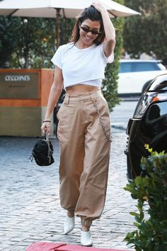 Kourtney Kardashian just stepped out in the coolest pair of pants by this It brand. See how she styled them here.