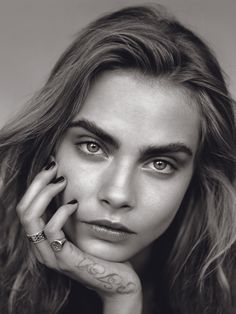 cara Delevingne. Very famous model with attitude and unique look.