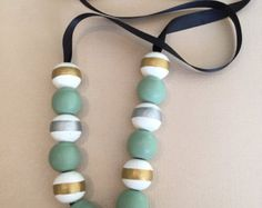 Black and gold color block necklace by KraftBasket on Etsy