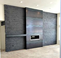 Here is a candid shot of a hot roll/natural steel fireplace and mantel we did out in Minot, ND. We went with a super clean tightly seamed installation. The heat markings and grain of the metal really make an impact with the unique look. The use of these materials are trending heavily right now in the design world and we expect to see alot more use of these materials in the future