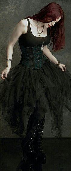 <3 love the dress & dark red hair