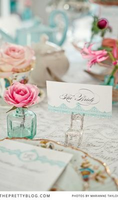 Quirky tea table | Flower arrangements | Blue & Pink theme | Roses | Photography by Marianne Taylor Photography