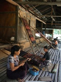 Busy house: A traditional house in East Sumba being used to weave and warp looms. (Photo courtesy of Threads of Life)