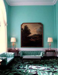 Hollywood Regency living room, love the botanical print of the rug!