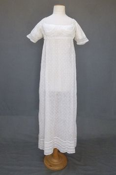 Scottish Embroidered Gown, c. 1805, fine embroidered muslin, scoop neck bodice, linen lined bodice and original ties to the front, short slightly shaped sleeves, back with deeply inset sleeves,fall front with similar lace curving inserts and vertical fine tucks as sleeves, apron skirt gathered with original linen ties, Meg Andrews Antique Costume and Textiles