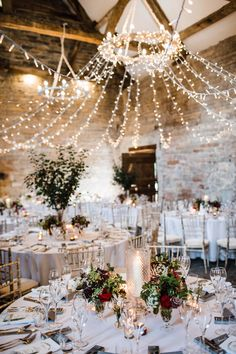Grace and Adam's barn wedding at Almonry barn in Somerset showcased how warm and cosy you can make a venue with fairy lights and candles and simple centrepieces. Click through for more barn wedding decor ideas from their wedding. Christmas Wedding Decorations, Wedding Venue Decorations, Rustic Wedding Venues, Wedding Lighting Decor, Christmas Wedding Pictures, Winter Wedding Ideas, Diy Christmas Wedding, Dallas Wedding Venues, Event Lighting