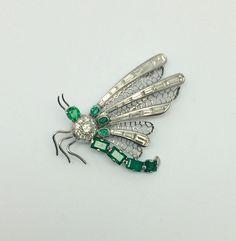 An antique emerald & diamonds butterfly brooch