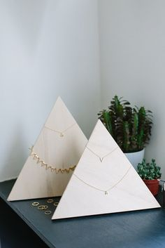 Plywood Jewelry Stand | A Pair & A SpareNecklaces must be one of the hardest things to display, especially fine pieces. These jewelry stands are not only incredibly simple to put together, but the plain wood makes the pieces stand out! Though if you wanted to add some snowy caps to make little mountains, a stain or pastel wash on them, then go for it!