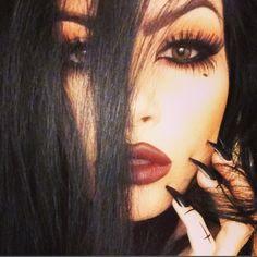 Dark smokey goth makeup. Wicca witch inspired. Eyeliner. Wine red burgundy lips. Long sharp black nails.