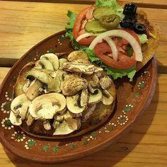 Day 9 of Vegan Mexico  Mushroom Burger with Lettuce Tomato Onion Jalapeño Pickles Olives Mustard Ketchup on a fresh Whole Wheat Bun #mexico #veganmexico #veganmexicofood #mexicanfood #mushroomburger #veganburger
