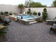 A range of earth tone colors and textures were incorporated in the stonework and decking to create the Old World design. Vertical walls were faced with natural ledge stone and finished with a chiseled stone cap. The decking was crafted by incorporating small tumbled cobblestone pavers.