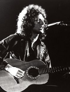 Here's Brian May playing the Ovation that inspired me to get one for myself. Queen Guitarist, Best Guitarist, Brian Rogers, Queen Brian May, Queen Pictures, We Will Rock You, Most Handsome Men, Freddie Mercury, Playing Guitar