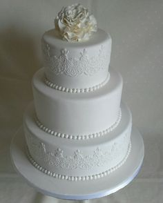 David Austin icing #rose topper #lace n pearls #wedding cake all white & all edible created by MJ www.mjscakes.co.nz in sunny Hawkes Bay NZ delivered to Craggy Range Winery David Austin, Celebration Cakes, Icing, Wedding Cakes, Fancy, Create, Mj, Rose, Desserts