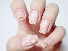 Flowers in pink nail polish- perfect for wedding nail art