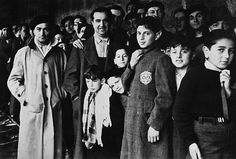"""Jewish deportees in the Drancy transit camp near Paris, France, in 1942, on their last stop before the German concentration camps. Some 13,152 Jews (including 4,115 children) were rounded up by French police forces, taken from their homes to the ""Vel d'Hiv"", or winter cycling stadium in southwestern Paris, in July of 1942. They were later taken to a rail terminal at Drancy, northeast of the French capital, and then deported to the east. Only a handful ever returned."""