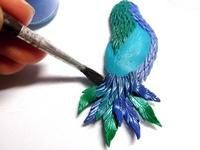 Here's a very pretty tutorial (in Russian) for making a shimmery bird pin with polymer clay and (I think) mica powder!