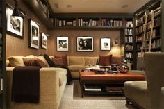 I love how the books are high up to leave room on walls for frames! #tvroom #library