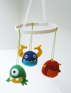 Embroidery hoop mobile - monsters