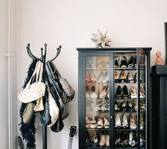 A glass front cabinet for shoes..wow  Great idea for purses