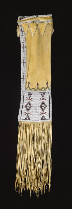 CHEYENNE BEADED HIDE TOBACCO BAG composed of finely tanned hide, thread and sinew sewn in opaque and translucent glass beadwork, the lower panel with pairs of stepped diamonds, surmounted by spot-stitched feather motifs, repeated on the reverse, the opening trimmed with a series of triangular tabs edged in white beads.