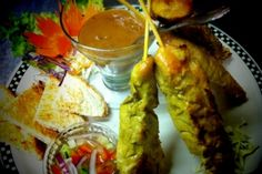 Chicken Satay: Marinated in a mixture of spices, herbs, and coconut milk grilled skewers served with peanut sauce and pickled cucumber. From Sugar Thai Cuisine in Sedro Woolley, WA