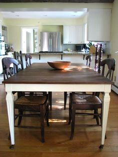 I'm in love with this kitchen table and the mis-matched antique chairs!