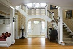 Traditional Entryway with Paint, Glass panel door, Chandelier, Laminate floors, interior wallpaper, Moravian star pendant