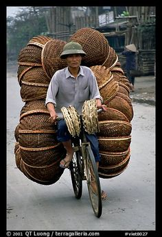 How large a load can you have on  a bicycle ?  On the way to the Perfume Pagoda. Vietnam (color)