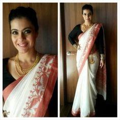Kajol in half white handloom saree with black full sleeves blouse by Sabyasachi Mukherji