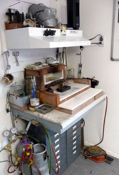 A vented hot work station with a selection of 4 torches is in one corner. There is also melting and pouring ingots, annealing and soldering area.