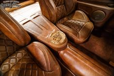 1955 Chevy Nomad custom Italian leather diamond stitched seats, faux finished console and trunk