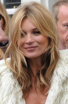 KATE MOSS's hair has a few layered slightly messy & wavey piecey strands