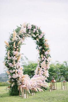 floral circular wedding ceremony arch