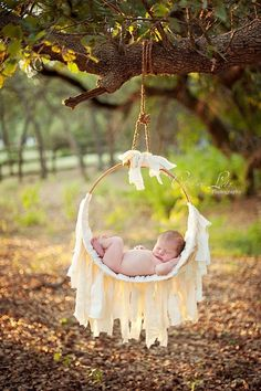 """This is another Woodsy Wonders Original Newborn Muslin Hammock.  A perfect one of a kind prop for the cuddly sleeping babe.  Hammock is woven and tied in a natural muslin.  Another original design by Woodsy Wonders! Hammock comes with natural muslin ties as shown in the """"product"""" photo. Because we value baby's safety, ALL of our hammocks"""