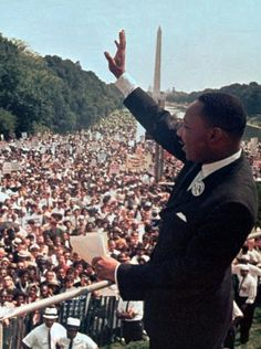 """The Rev. Martin Luther King Jr. waves to the crowd at the Lincoln Memorial for his """"I Have a Dream"""" speech during the March on Washington for Jobs and Freedom on Aug. 28, 1963. The march was organized to support civil rights legislation and end segregation and job discrimation."""