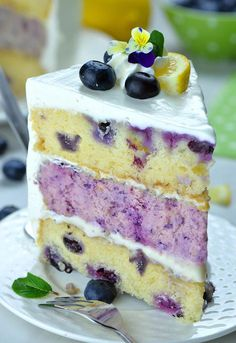 A decadent blueberry cheesecake kissed by lemon hiding inside a layer cake. Perf… A decadent blueberry cheesecake kissed by lemon hiding inside a layer cake. Lemon Blueberry Cheesecake, Blueberry Desserts, Blueberry Cake, Lemon Cheesecake, Chocolate Desserts, Blackberry Cupcakes, Raspberry Cake, Cheesecake Recipes, Cheesecake Pancakes