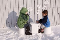 """ice chairs and table! fill up boxes with snow the day before, let freeze, assemble! so awesome. also loving the snowflake decorations on the fence! """"hot chocolate party"""" - such a fun idea!"""