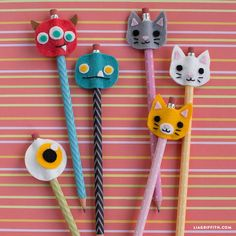 Our back to school felt pencil toppers feature cute monsters and kitty cat designs that you can craft with your kids before the school year starts!