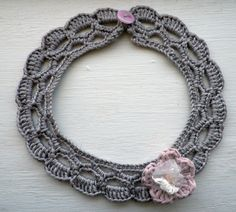 Grey soft wool crochet collar with a pink cotton and lace flower. https://www.etsy.com/uk/shop/MazeOfLace?ref=si_shop