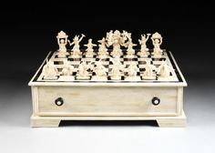 A LARGE INDIAN CARVED BONE AND HORN CHESS SET, MODERN,