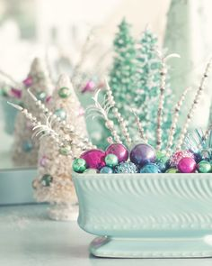 Vintage aqua Christmas for shabby or beach cottage..love the upcycle use of the vintage planter.