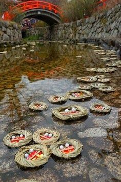 "Nagashi hiina, Kyoto, Japan. ""Floating hina-dolls down to the sea."" March 3 every year dolls in a wooden box with a paper crane are floated to sea after the Shinto priest exorcises evil spirits."