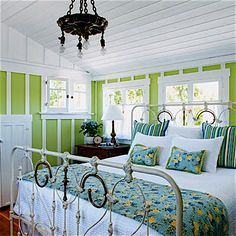 Tucked under a dormer, this master bedroom kept its existing tongue-and-groove ceiling while gaining ventilation, knee-wall storage, and a painted iron bed. Old Cottage, French Country Cottage, Cottage Living, Coastal Living, Living Room, Home Bedroom, Bedroom Decor, Bedroom Ideas, Budget Bedroom