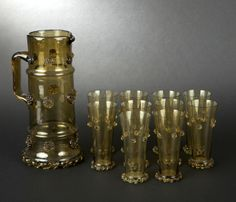 Vintage smoky glass orangeade service of ten wide goblets and a pitcher with inlaid blossoms decorations, prob. Germany or Bohemia Cuppa Tea, Glass Pitchers, Decanter, Blossoms, Tableware, Germany, Bohemian, Decorations, Vintage