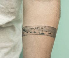 Thailand inspired hand poked armband tattoo on the left forearm.